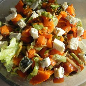 Salad with pumpkin, cheese and pine nuts