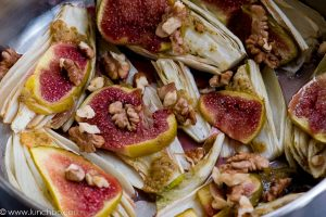 Hot chicory salad with figs and walnuts